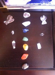 Chakra crystals layout with clear quartz and Angel crystals surrounding them!